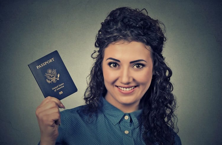 Young Woman Holding Passport
